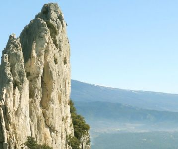 the-ciseled-crest-of-dentelles-montmirail-overlooking-mont-ventoux